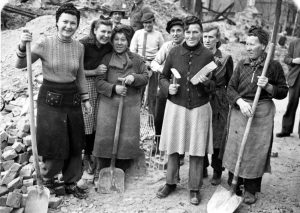 Seven of the many thousand so called rubble women (Truemmerfrauen) pose holding their tools for the camera in the totally bombed out Berlin, Germany, December 22, 1948. (AP Photo)